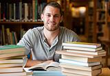 Smiling student surrounded by books
