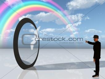 Man in black points toward rainbow in surreal landscape