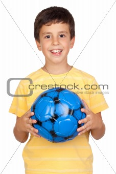 Adorable boy with a blue soccer ball