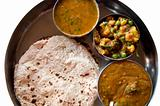 Traditional Indian cuisine vegetarian thali served in small bowl