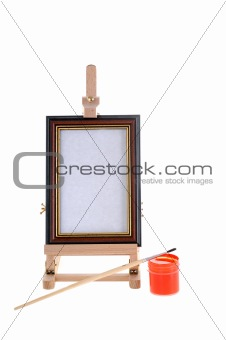 Paint, brush and an easel