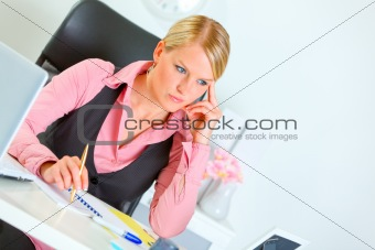Business woman sitting at office desk and thinking