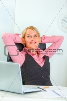 Happy business woman relaxing at office