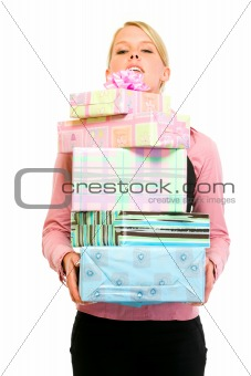 Smiling business woman looking out from pile of gifts