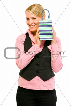 Smiling business woman holding gift bag