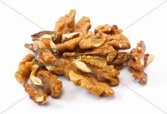 Crushed walnuts on white background