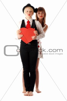 Two girls with red cardboard heart