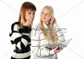 Two beautiful girls read diary book on white background