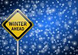 winter ahead traffic sign on snowing background
