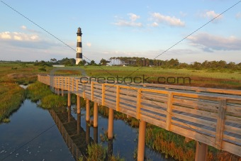 Walkway over a marsh to the Bodie Island lighthouse