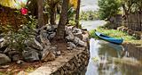 peaceful corner of Kerala Backwaters canoe flower