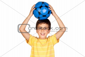 Adorable boy with a blue soccer ball