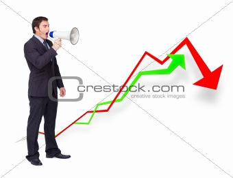 Handsome businessman using a megaphone