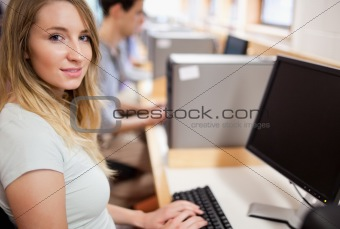 Cute student with a computer