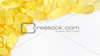 yellow fish oil capsule pile