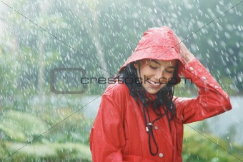 Woman enjoying rain outdoors