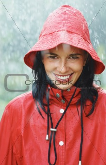 Woman smiling while standing in rain