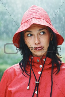 Woman contemplating while standing in rain