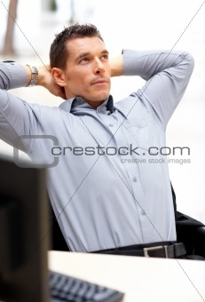 Young business man looking upwards in thought