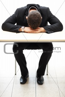Fatigue - Male business executive sleeping at his desk