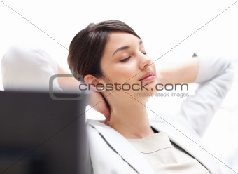 Pretty business woman resting at her desk