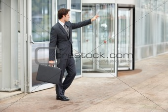 Smart young businessman hailing a taxi cab