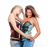 two young happy female friends embracing, smiling - isolated on white