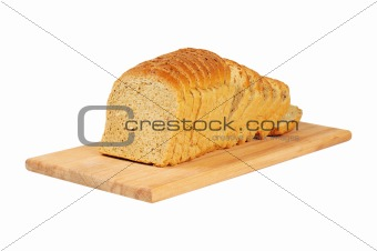 Sliced bread on wooden board.