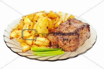 Grilled meat and  fried  potatoes  on a plate