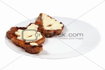 Grilled meat  with  mayonnaise  on a plate.