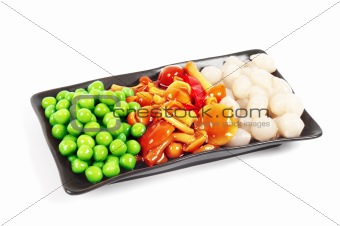 A plate of pickles. Peas, mushrooms and onions