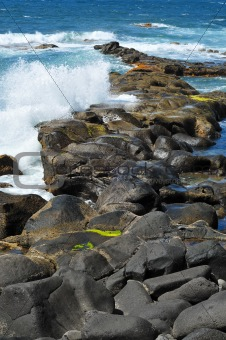 sea waves breaking on the rocks