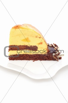 Piece of chocolate cake with mango