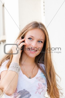 Portrait of a smiling young businessman giving call me gesture o