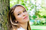 beautiful young attractive woman outdoors portrait on green back