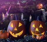 Halloween pumpkins in the grave yard