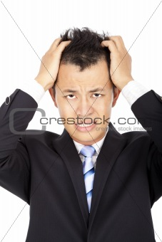 Stressed young asian businessman with headache on white
