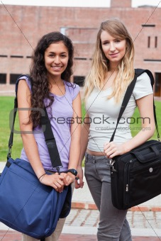 Portrait of smiling female students posing