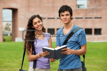 Couple holding a book