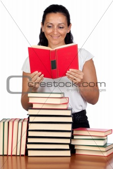 Attractive woman reading in a library