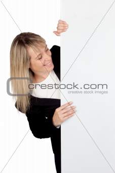 Blonde businesswoman with a big poster