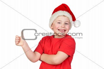Adorable child with Santa Hat saying Ok