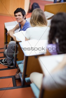 Portrait of a handsome student being distracted
