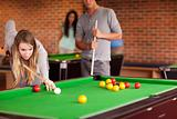 Friends playing snooker