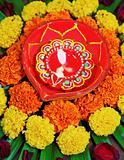 IMG_4586 portrait Hindu floral rangoli Diva marigolds
