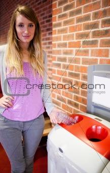 Cute woman recycling