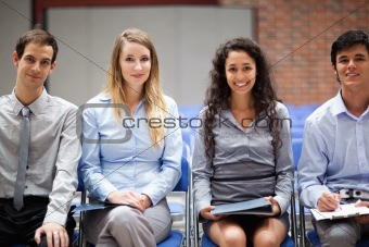 Business people sitting on chairs