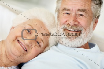 Senior man with a loving mature female