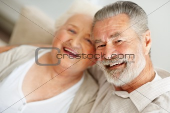 Happy senior man spending time with a smiling mature female