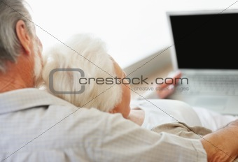 Elderly couple working on laptop - Indoor